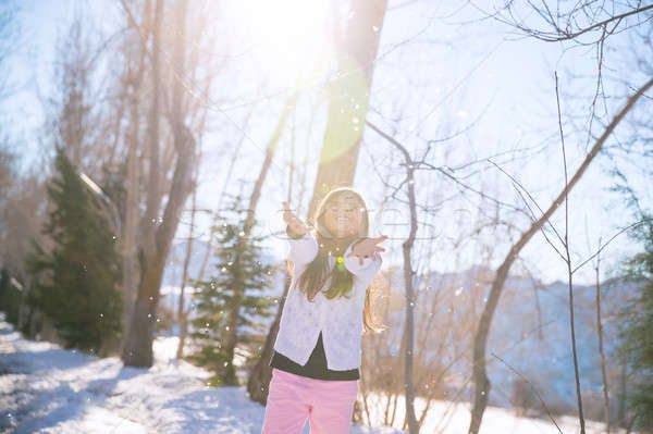 Little girl catching snowflakes Stock photo © Anna_Om