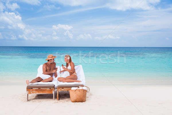 幸せ カップル ビーチ 座って サンベッド ストックフォト © Anna_Om