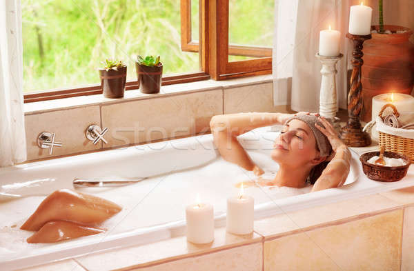 Woman relaxing at spa resort Stock photo © Anna_Om