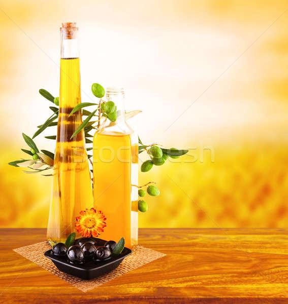 Olio d'oliva ancora vita foto tavolo in legno tramonto vetro Foto d'archivio © Anna_Om