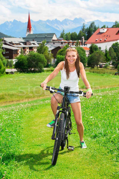 Happy woman on bicycle Stock photo © Anna_Om