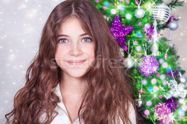 Beautiful girl near Christmas tree Stock photo © Anna_Om