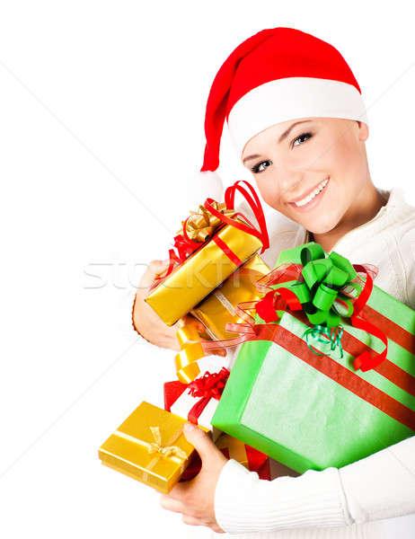 Happy Santa girl holding Christmas gifts Stock photo © Anna_Om