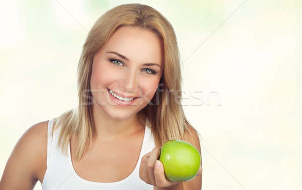 Pretty woman with apple Stock photo © Anna_Om
