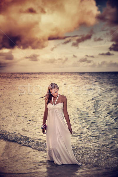 Woman on the beach in overcast weather Stock photo © Anna_Om