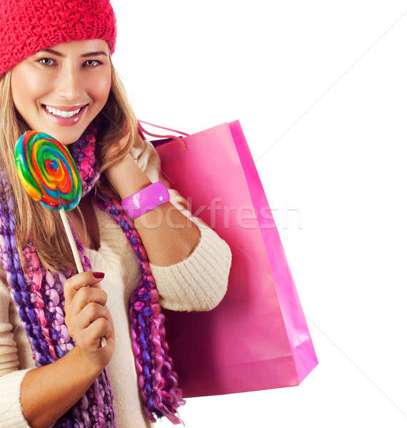 Pretty female with candy and paper bag Stock photo © Anna_Om