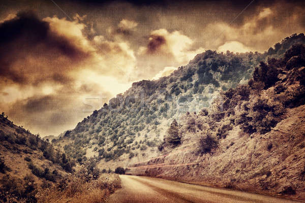 Grunge photo of road in the mountains Stock photo © Anna_Om