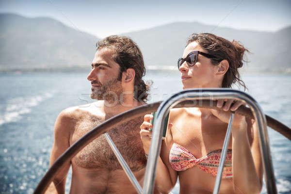 Beautiful couple on sailboat Stock photo © Anna_Om