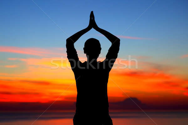 Stock photo: Doing yoga exercises outdoors