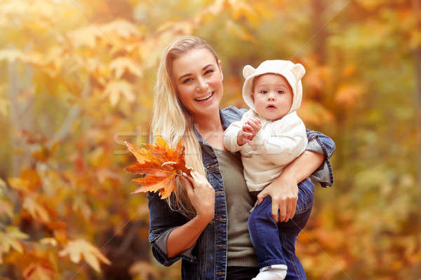 Happy mother with baby in autumn park Stock photo © Anna_Om