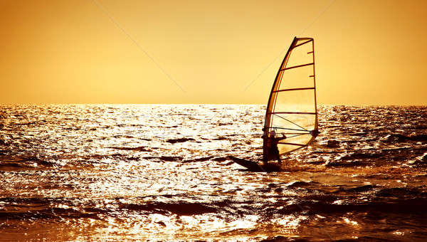 Windsurfer silhouette over sea sunset Stock photo © Anna_Om