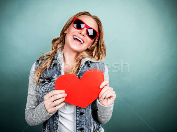 Stock photo: Cheerful female with paper heart