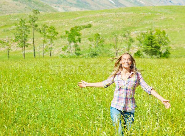Fiatal boldog nő sétál búzamező aranyos Stock fotó © Anna_Om