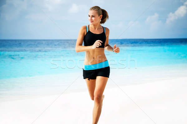 Woman running on the beach Stock photo © Anna_Om