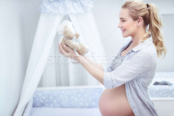 Pregnant woman in child's room Stock photo © Anna_Om
