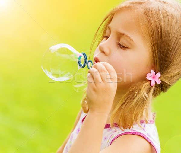 Kislány fúj szappanbuborékok édes kert nyár Stock fotó © Anna_Om