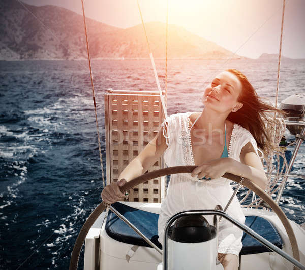 Kobieta za koła jacht morza Zdjęcia stock © Anna_Om