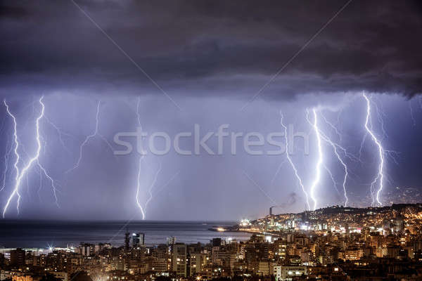 Night cityscape with strong lightning Stock photo © Anna_Om