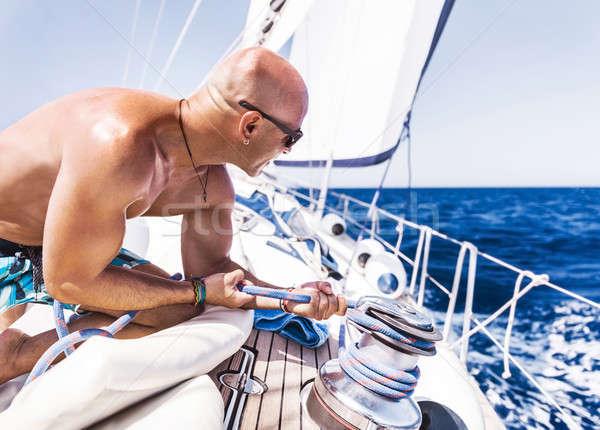 Handsome man on sailboat Stock photo © Anna_Om