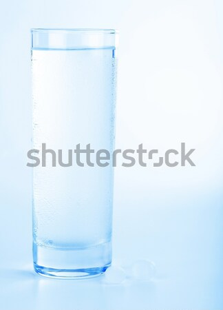 Vidro água doce médico pílulas estúdio isolado Foto stock © Anna_Om
