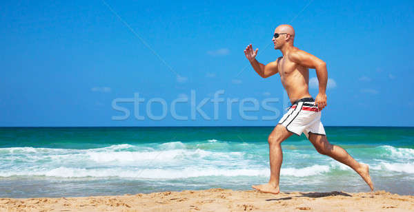 Stock photo: Healthy man running on the beach