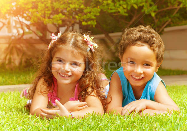Happy kids on green grass Stock photo © Anna_Om