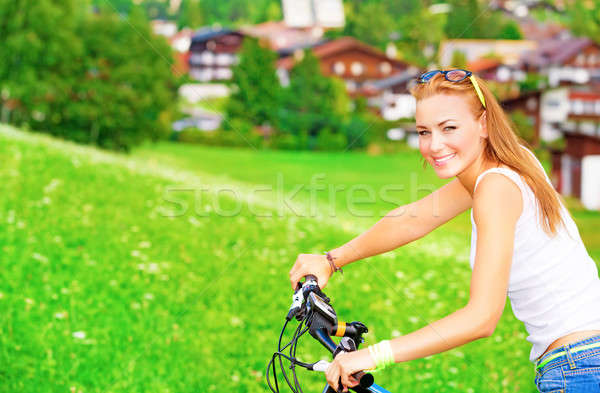 Sportive teen girl riding on bicycle Stock photo © Anna_Om