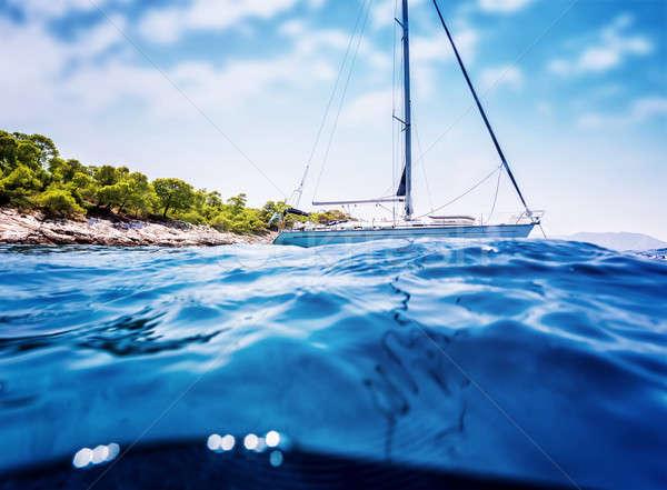 Luxury sailboat near tropical island Stock photo © Anna_Om