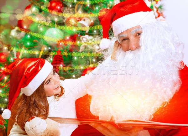 Cute little girl with Santa Claus  Stock photo © Anna_Om