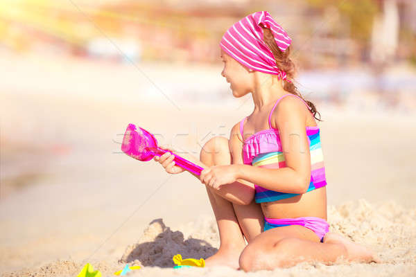 Happy girl playing on the beach Stock photo © Anna_Om