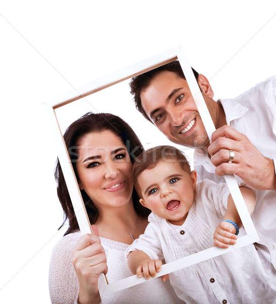 счастливая семья портрет изолированный белый , держась за руки кадр Сток-фото © Anna_Om