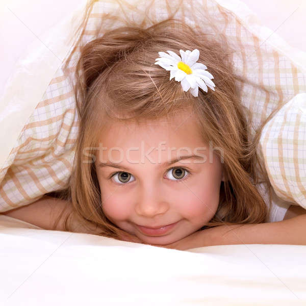 Stock photo: Little girl in the bed