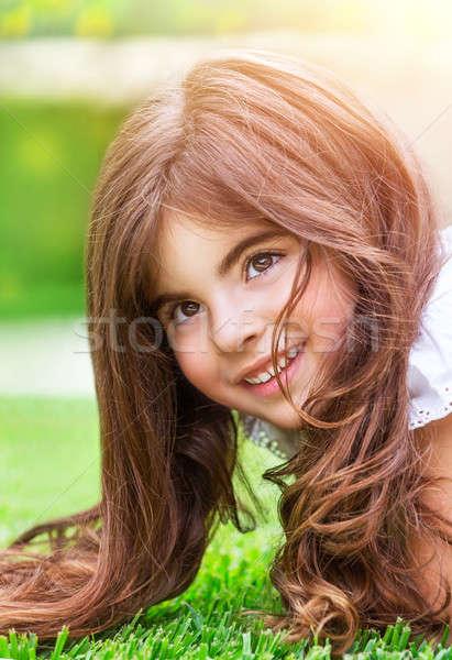 ストックフォト: 女の子 · 緑の草 · クローズアップ · 肖像 · かわいい