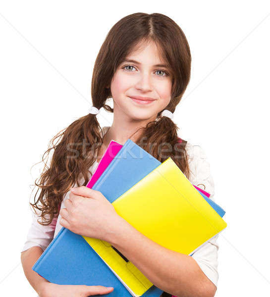 Cute schoolgirl with colorful books Stock photo © Anna_Om
