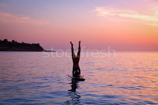 Woman doing yoga outdoors Stock photo © Anna_Om