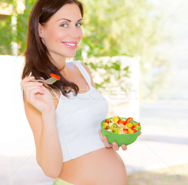 Pregnant woman eating salad Stock photo © Anna_Om