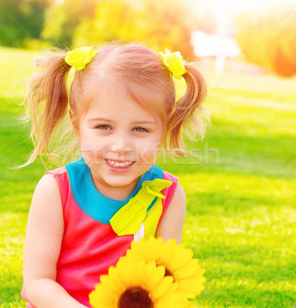 Stock photo: Little girl with sunflowers bouquet