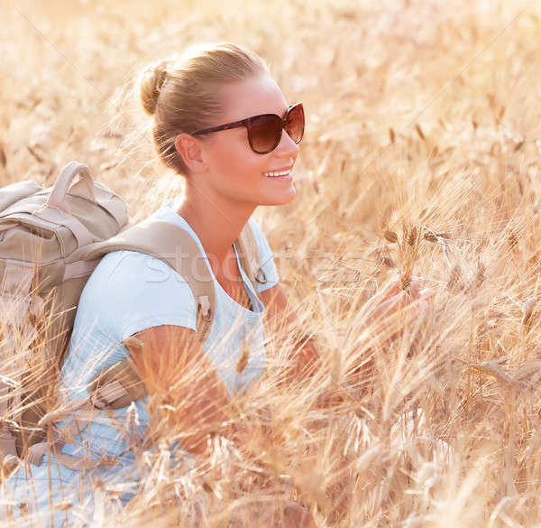 Happy traveler in wheat field Stock photo © Anna_Om