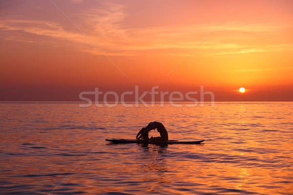 Woman trainings on the beach Stock photo © Anna_Om