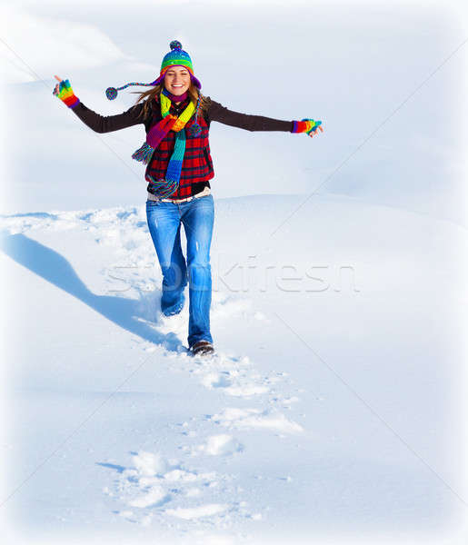 Happy girl running in the snow Stock photo © Anna_Om