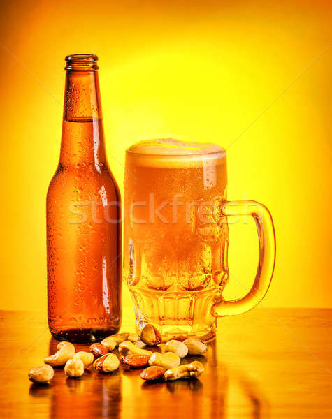 Bottle of beer and nuts Stock photo © Anna_Om