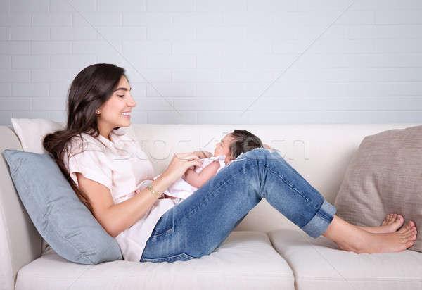 Boldog anyaság derűs fiatal anya ül Stock fotó © Anna_Om