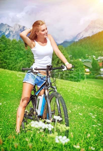 Happy woman on a bicycle Stock photo © Anna_Om