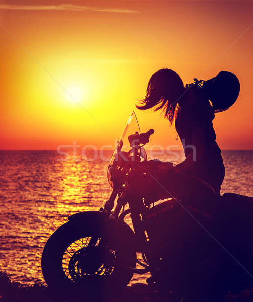 Silhouette of a biker woman Stock photo © Anna_Om