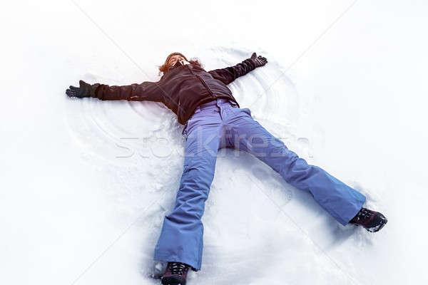 Młodych kobiet śniegu anioł wesoły Zdjęcia stock © Anna_Om