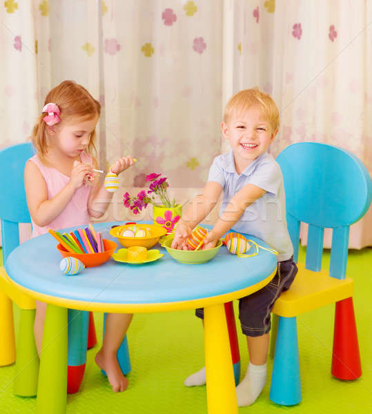 Happy kids paint Easter eggs Stock photo © Anna_Om