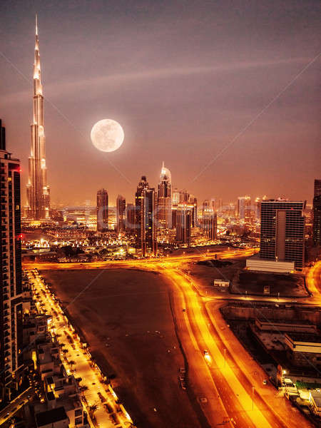 Dubai luar lua cheia noite centro da cidade moderno Foto stock © Anna_Om