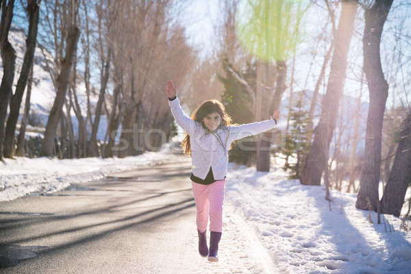 Happy girl runs and jumps up from happiness Stock photo © Anna_Om
