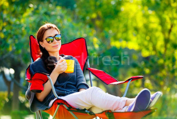 Beautiful woman resting outdoors Stock photo © Anna_Om