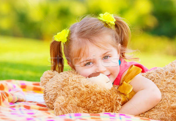Little girl hugging soft toy Stock photo © Anna_Om